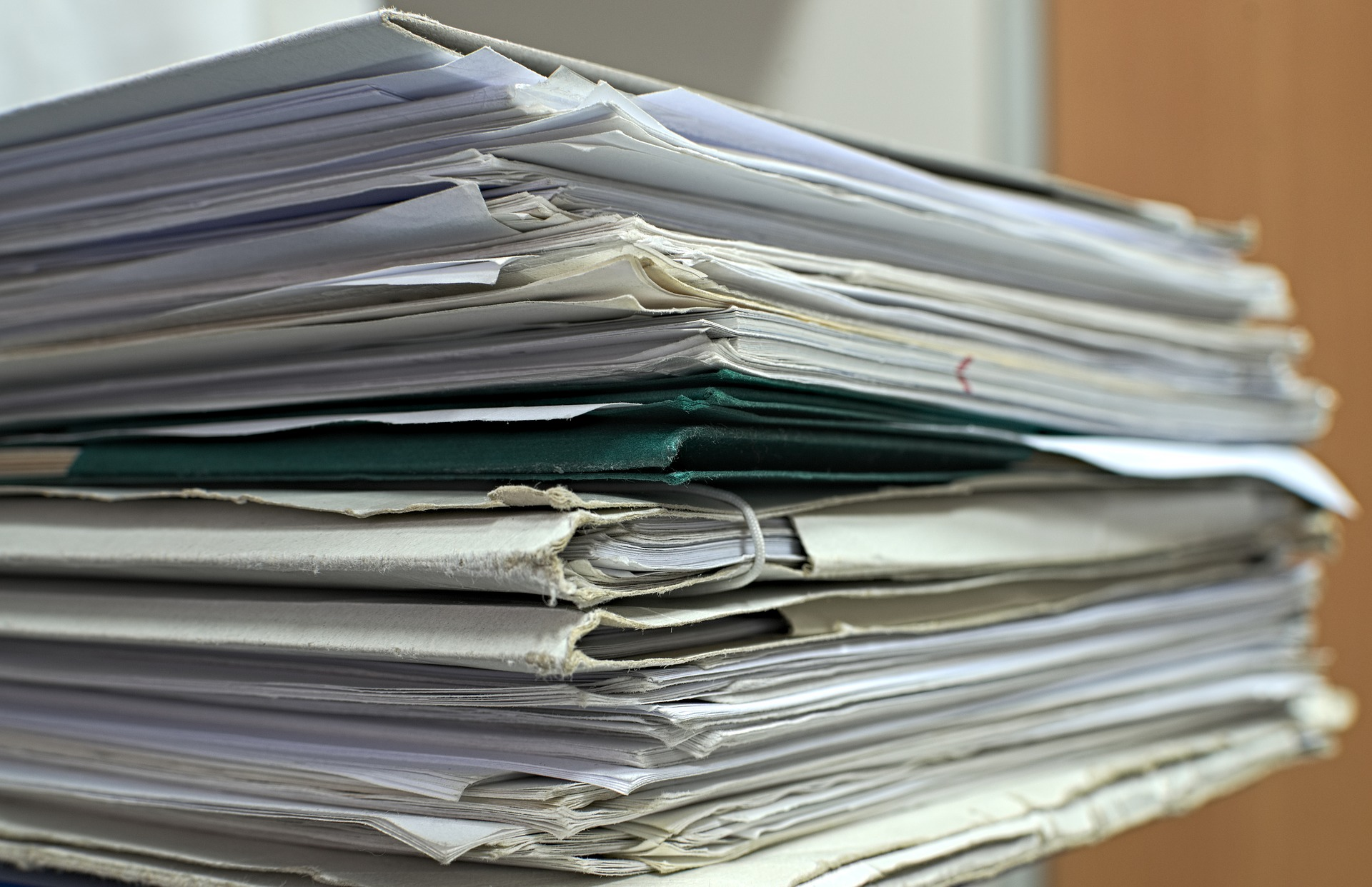 pile of papers for life binder